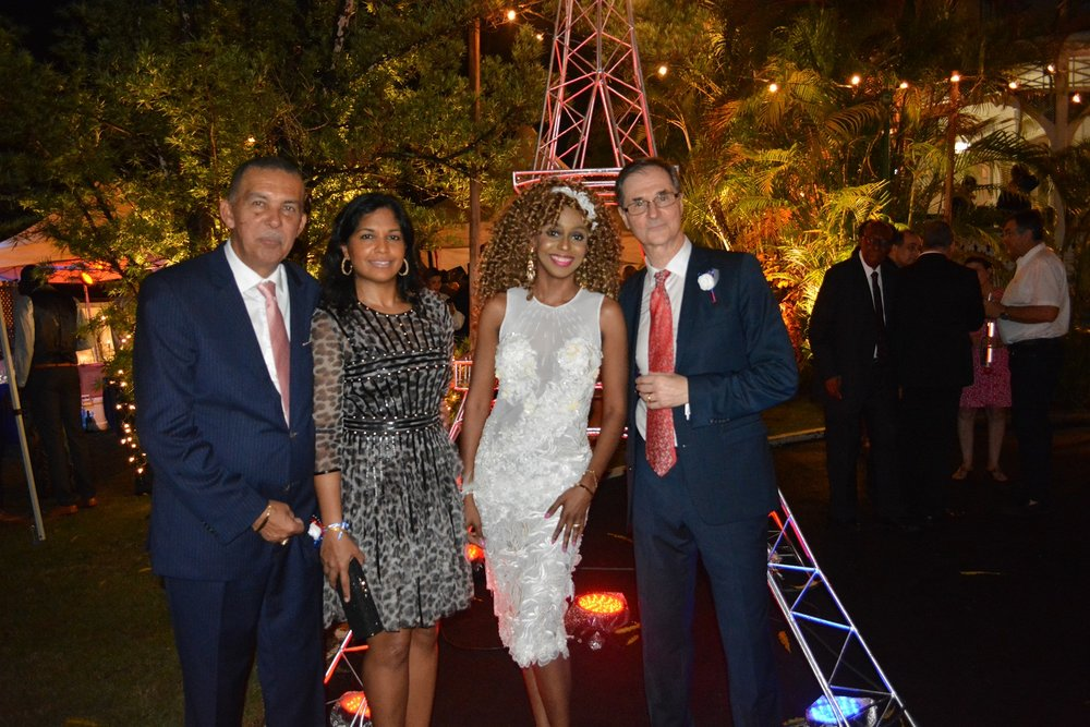 Ambassador Serge Lavroff and Mrs. Caroline Lavroff pose at the foot of the Eiffel Tower with Mr. Anthony Carmona, former President of the Republic of Trinidad and Tobago and Mrs. Reema Carmona,